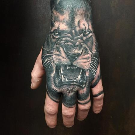 Tattoos - Realistic Lion in Black and Gray on the Back of a Hand - 126517