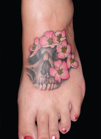Comments: Tattoo by Stretch. Skulls and flowers, what every girl should have