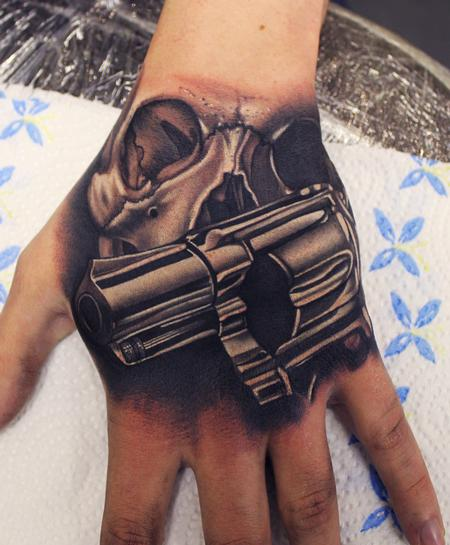 Phatt German - Skull and Gun Hand tattoo