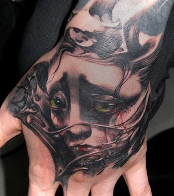 Asian girl face on hand by little dragon tattoonow for Asian face tattoos