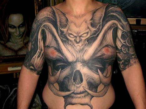 Paul Booth - Bat face with horned skulll chest and stomach tattoo
