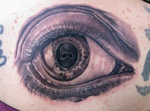 Phil Young - Skull in eyeball tattoo