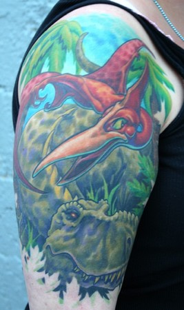 Phil Young - Dinosaur tattoo half sleeve