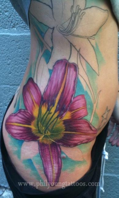 Phil Young - Lily tattoo on ribs in progress