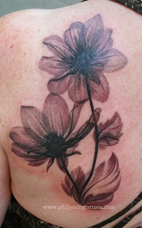 Phil Young - artsy magnolia tattoo