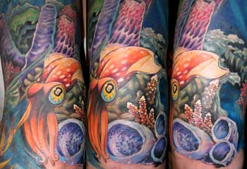 Looking for unique  Tattoos? squid in coral tattoo