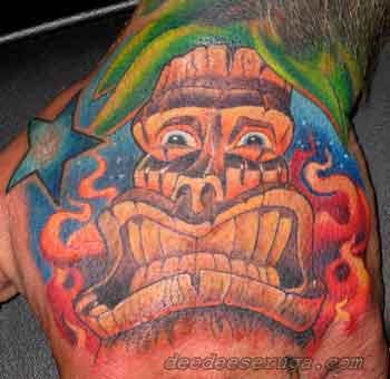 Looking for unique  Tattoos? tiki small color tattoo