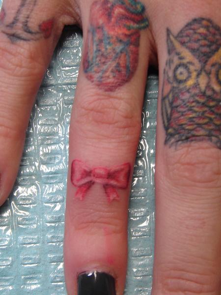 Mario Sanchez - 2407 Thousand Oaks Dr San Antonio  Texas 78232 Email    Bow Finger Tattoos