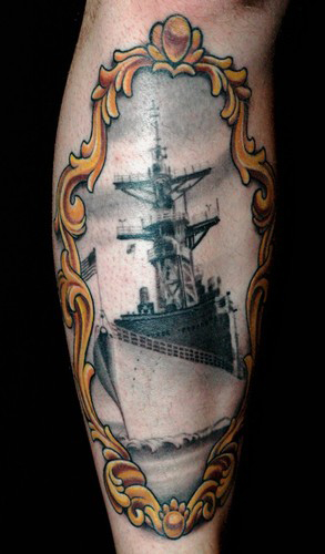 Russ Abbott - Battleship tattoo in a Victorian frame.