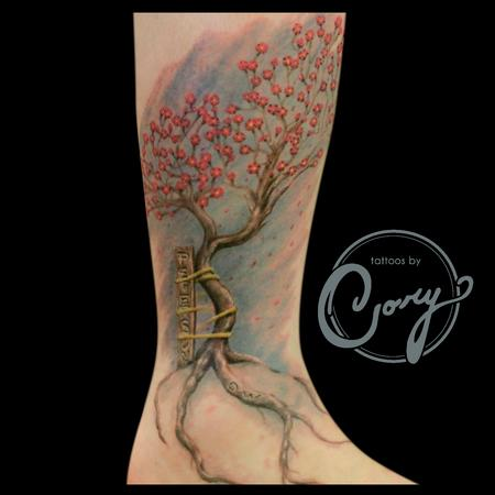 Supported cherry blossom tree by cory claussen tattoonow for Tattoo shops sioux falls sd