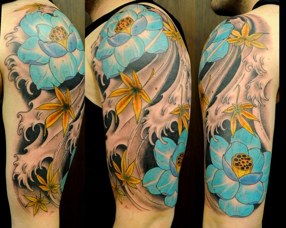 Japanese wave and flower tattoos