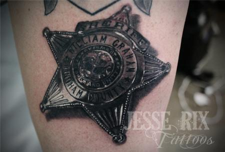 Jesse Rix - sheriff badge tattoo