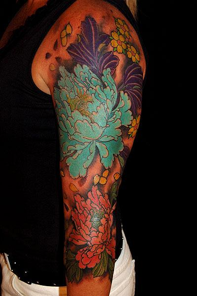 Dana Helmuth - peony and blossom tattoo with misty background