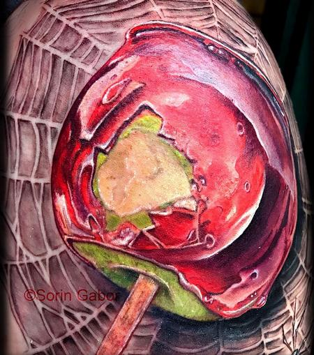 Sorin Gabor - realistic color candy apple on spiderweb tattoo