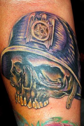 Aran Campas - Skull with helmet and Slayer eagle tattoo