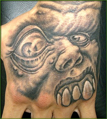 Demon on Hand Tattoo
