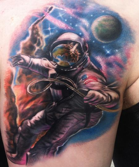 astronaut watching earth explode Tattoo Design Thumbnail