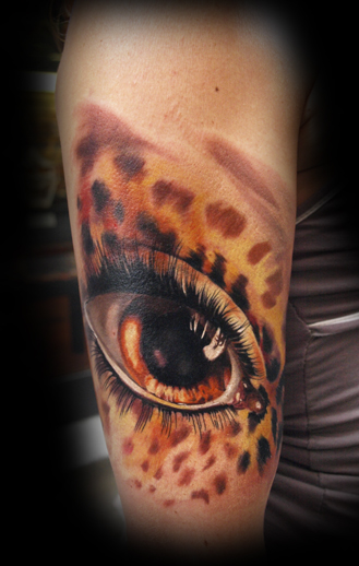 Leopard skin with human eye by michele turco tattoonow for Skin gallery tattoo