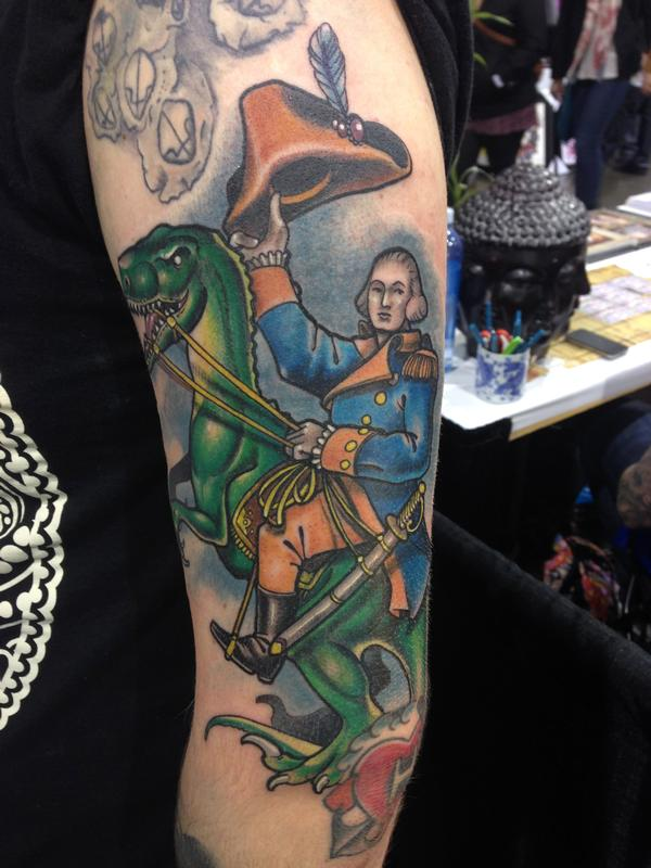 Custom george washington riding velociraptor by anthony for Tattoo shops in st george