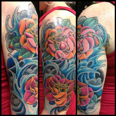 Color bomb lotus flowers and water by kr rossi tattoonow for Lotus flower bomb tattoo