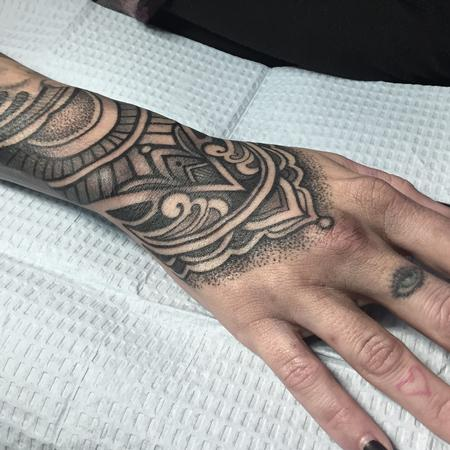 Laura Jade - Ornate hand tattoo with crescent moon