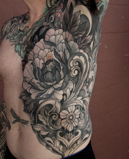 Laura Jade - Peony and filigree torso tattoo