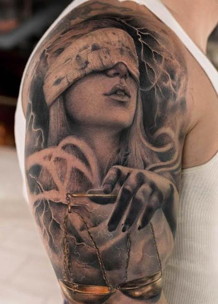 Lady Judgment Black and Gray Bicep Tattoo Tattoo Design