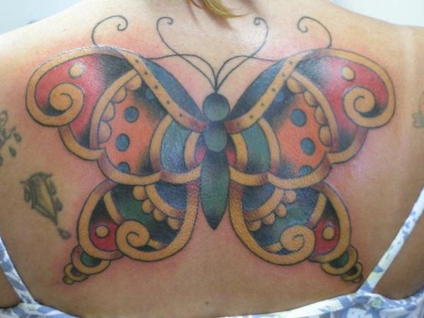 Traditional butterfly tattoo by keith underwood tattoonow for Taylor st tattoo