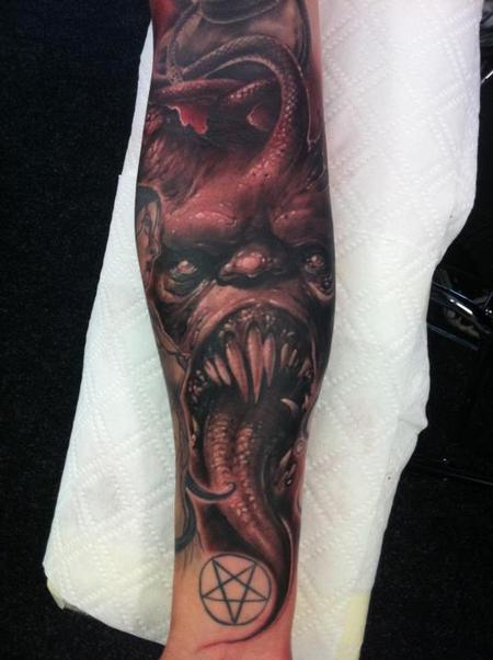 Tommy Lee Wendtner - evil forearm half sleeve tattoo
