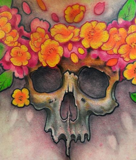 Skull and flowers chest tattoo detail