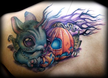 Kelly Doty - Zombie Bunny vs Pumpkin tattoo