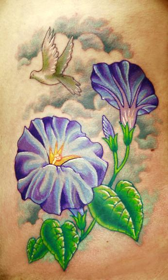 Morning glory's done on ribs Tattoo Design Thumbnail