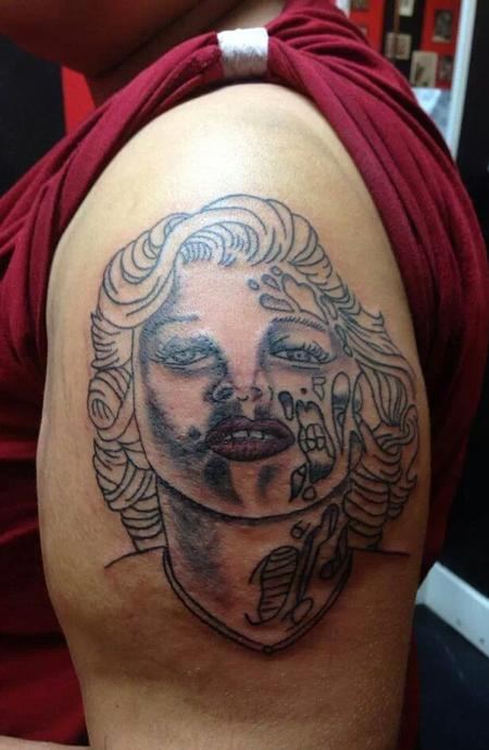 Bad Tattoos - Monroe looking dead.