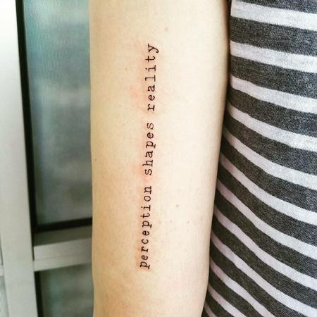 Perception Shapes Reality Script Tattoo Thumbnail