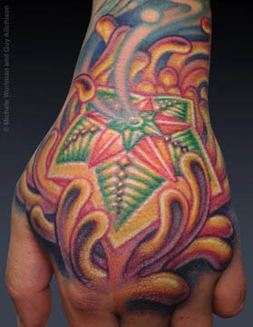 Guy Aitchison Michele Wortman collaborative hand tattoo