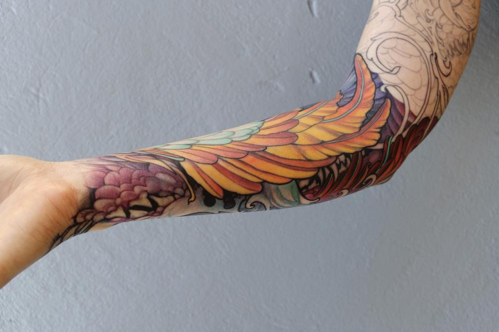 Tattoos - feathers and fangs - 115554
