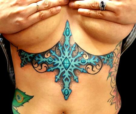 Jesse Neumann - Snow under breast tattoo