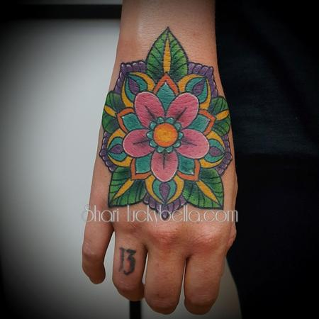 Tattoos - mandala on the hand - 129536