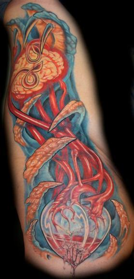 Evan Olin - Bio side piece with brain and glass heart tattoo