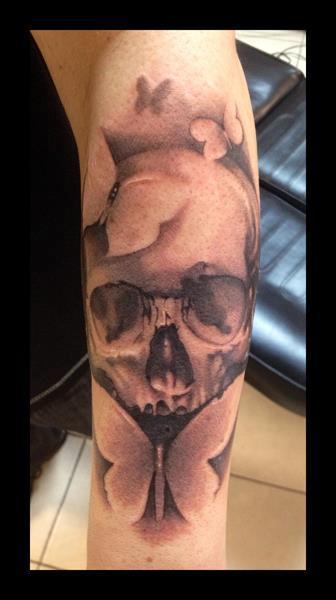 Skull and Butterflies Tattoo Design