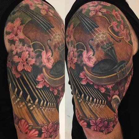 Music and Floral Half Sleeve Tattoo Design