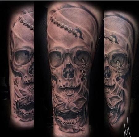Matt Morrison - Black and Grey Skull with Lotus Tattoo