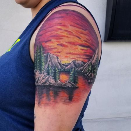 Cody Cook - color trees sunset mountain range shoulder tattoo