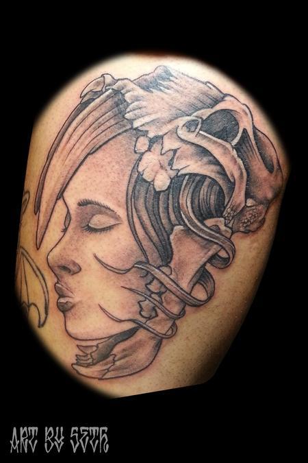 Face and Skull Tattoo Design