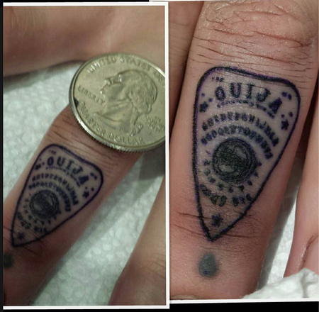 Tattoos - tiniest letters ever ouija plachette - 79663