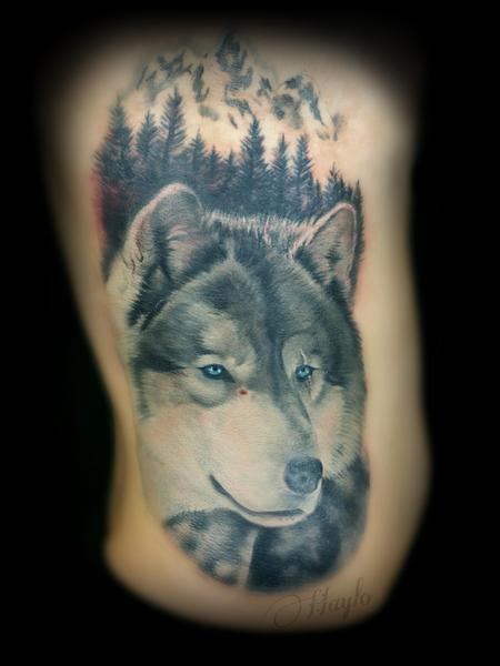 Haylo - Wolf and mountain scene tattoo in progress