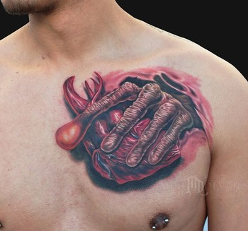 Mike DeVries - ET Hand Tattoo